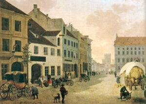 Kleine Anfänge: Die Spatenbrauerei in der Neuhauser Straße in München um 1840 (weißes Gebäude auf der linken Seite), im Hintergrund das Karlstor (Foto: Stadtarchiv München)